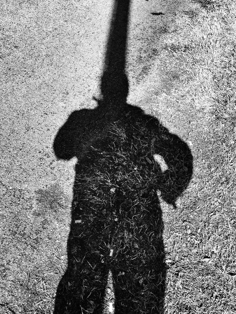 Shadow self-portrait of photographer Keith Dotson with a telephone pole shadow
