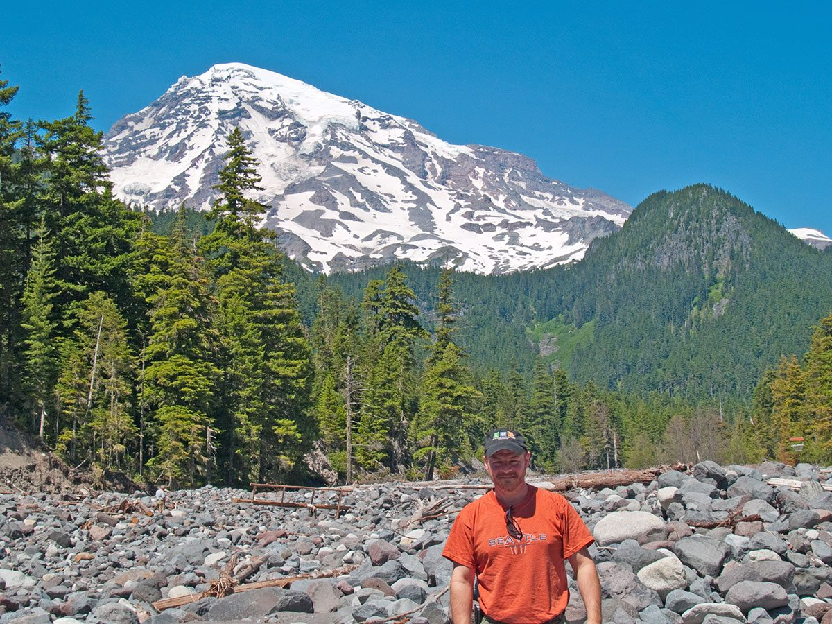 Photographer Keith Dotson at the base of Mt. Rainier, in 2007.