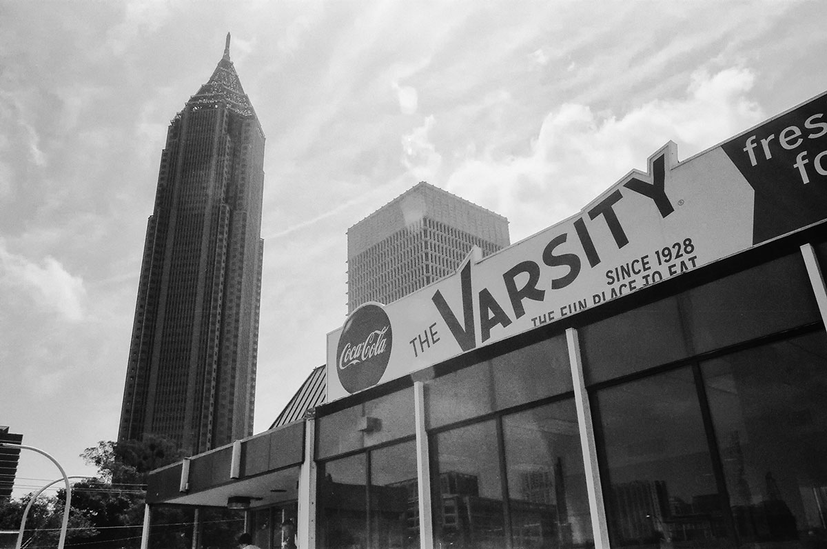 Shooting into the glare of the sun to get an image of The Varsity's vintage burger stand sign.