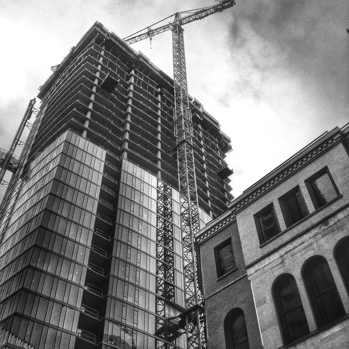 Construction cranes are a common sight in Nashville. Black and white photo by Keith Dotson.