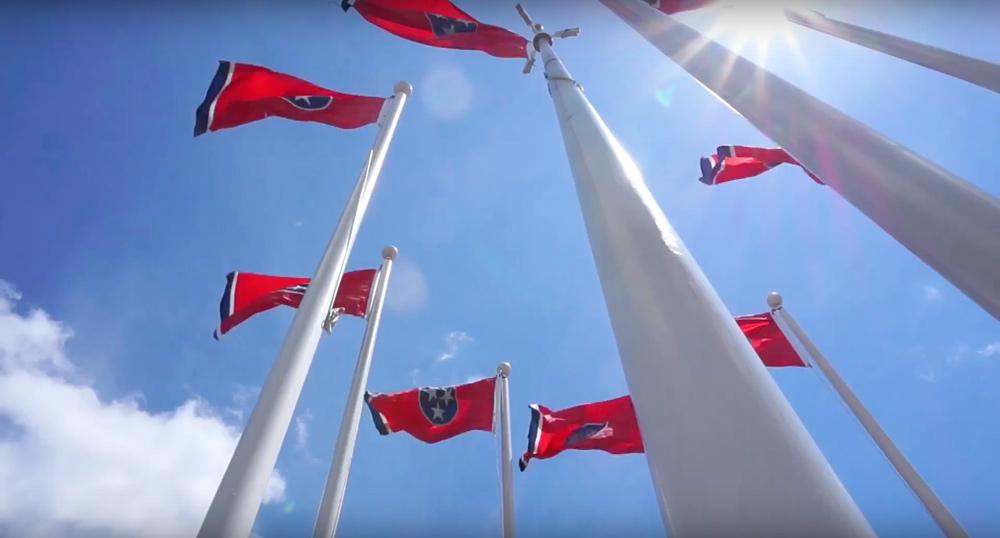 tennessee flags waving against a blue nashville sky.jpg