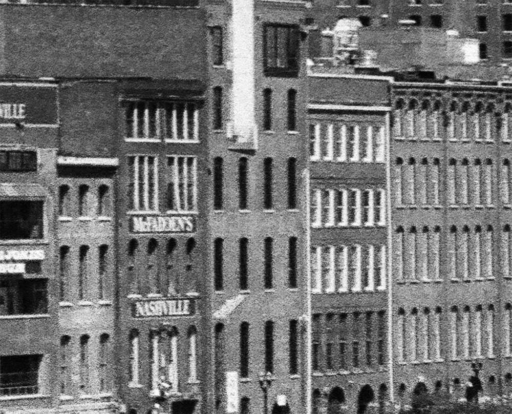 Film grain and sharpness detail from the photograph above, showing a detail of the historic Nashville waterfront buildings along 1st Avenue.