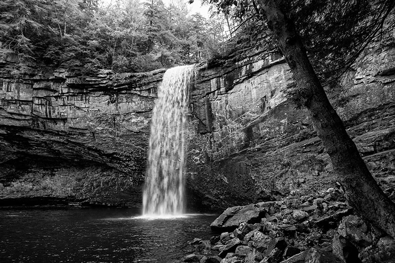Black and white landscape photograph of a waterfall
