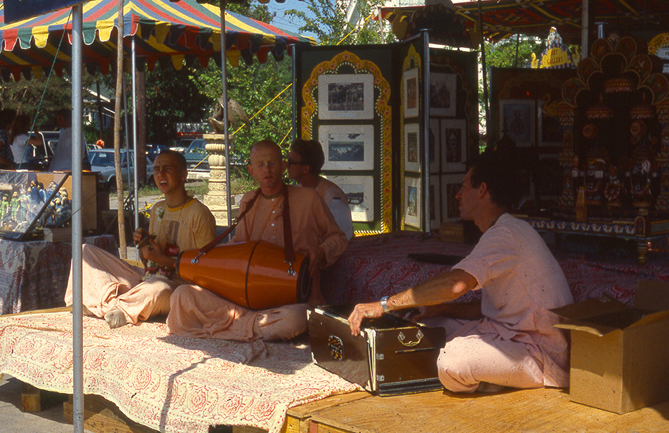 Hare Krishna devotees seen at the entrance to the Houston Zoo in the early 1980s, shot on slide film by Keith Dotson. All rights reserved.