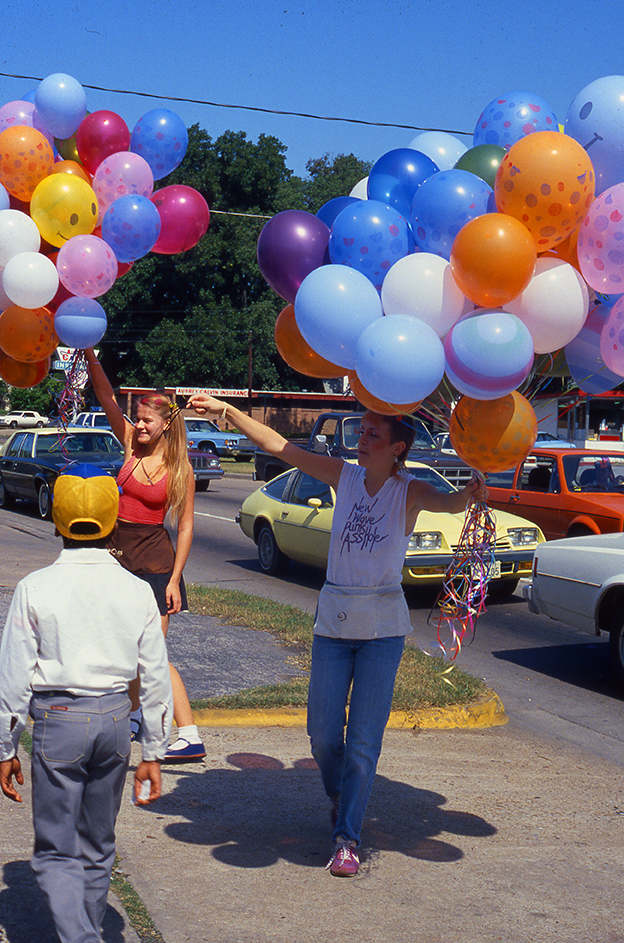Balloon seller at Westheimer Street Festival in Houston, early 1980s, shot on slide film by Keith Dotson. All rights reserved.