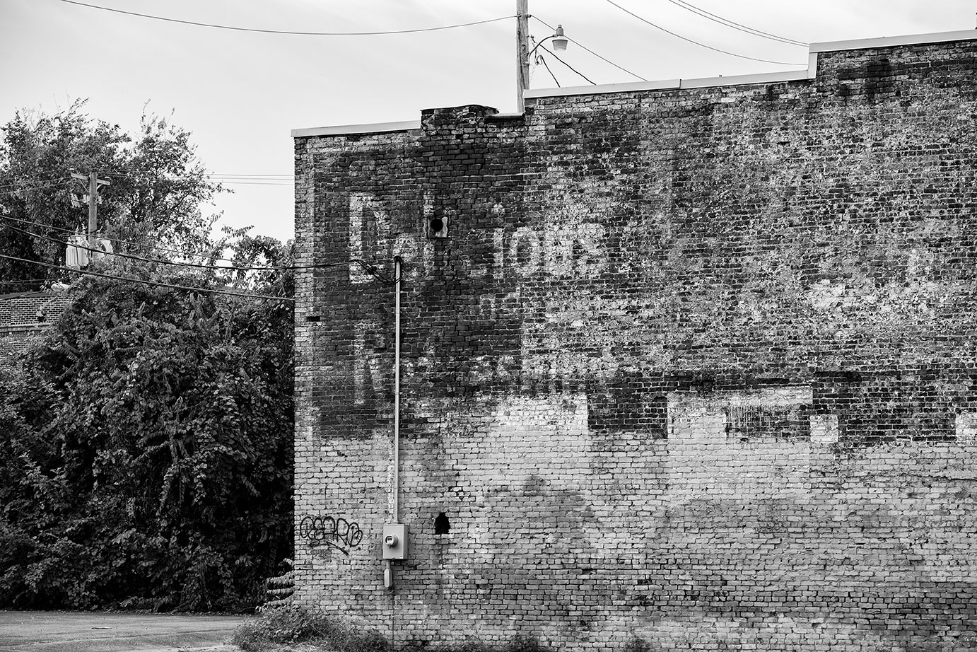 Ghost Sign Ad on an Old Brick Wall
