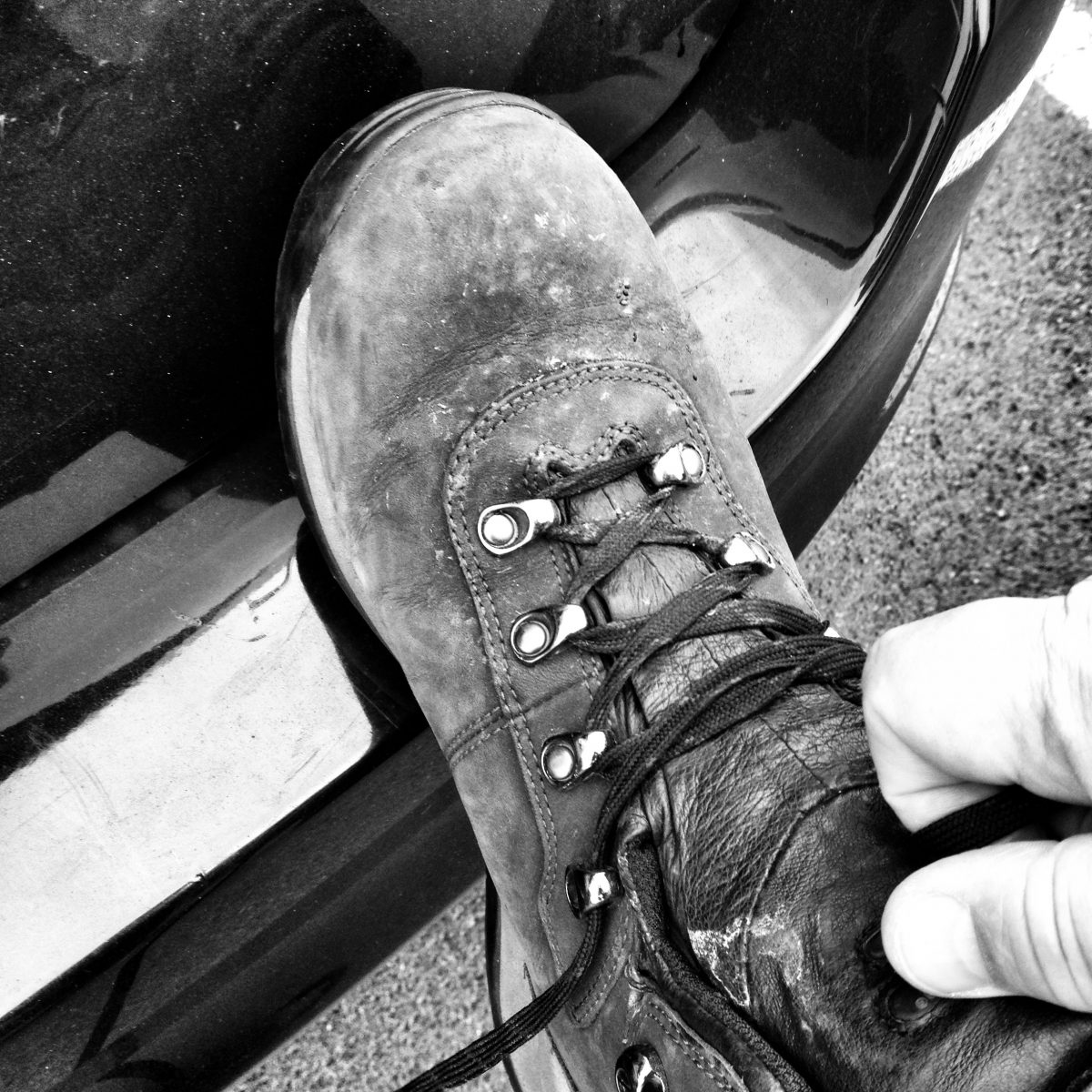 When I lace up my hiking boots, I know I'm in for a good day. Picture of a hiking boot in black and white