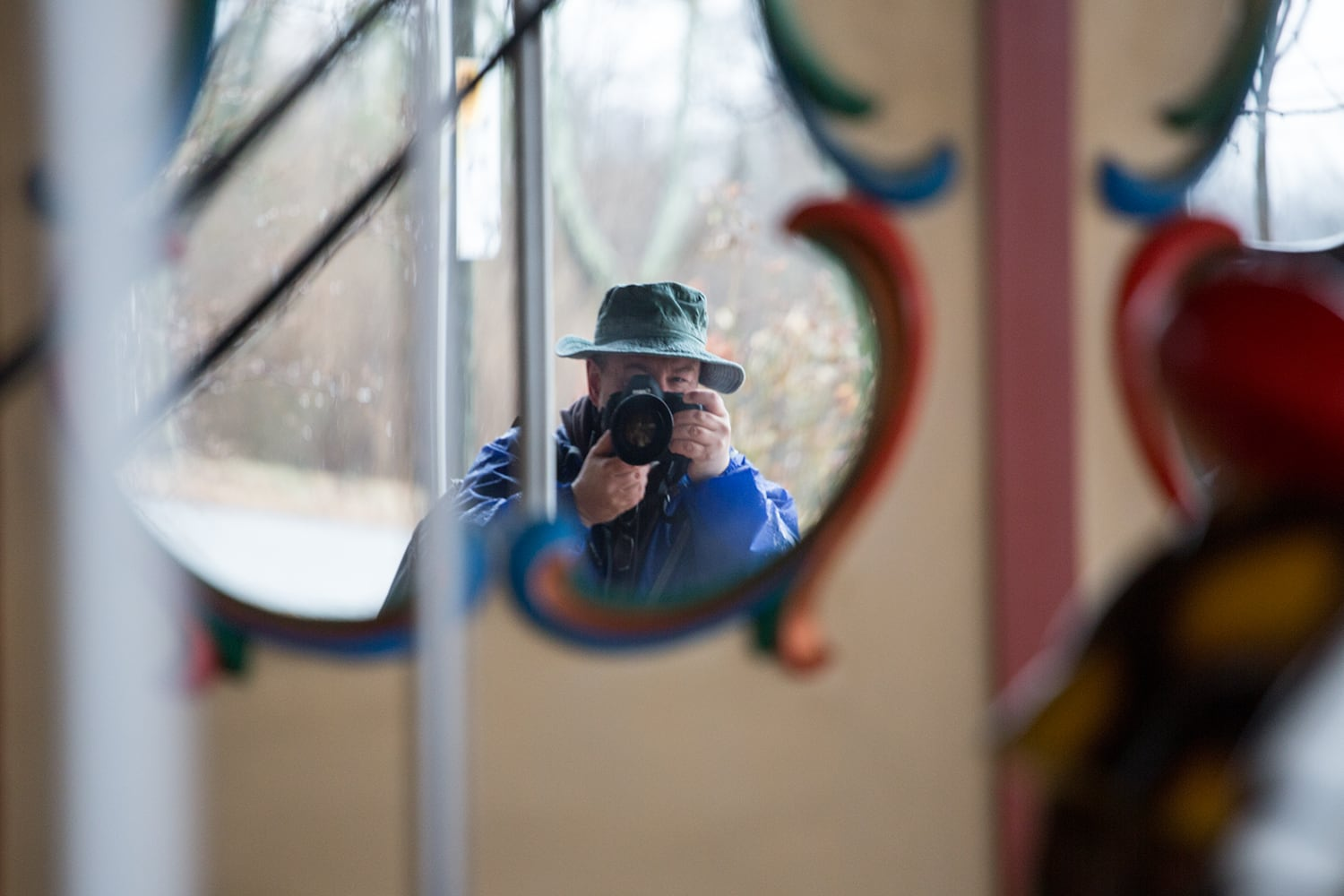 Self Portrait Reflected in a Carousel Mirror