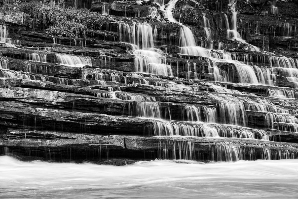 Keith Dotson's black and white photograph of a cascading waterfall