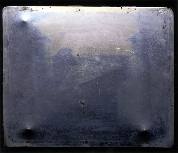 A photograph of the world's first photograph, which can be seen under light-controlled conditions at the Harry Ransom Center in Austin. Photo by J. Paul Getty Museum. Gernsheim Collection, Harry Ransom Center.