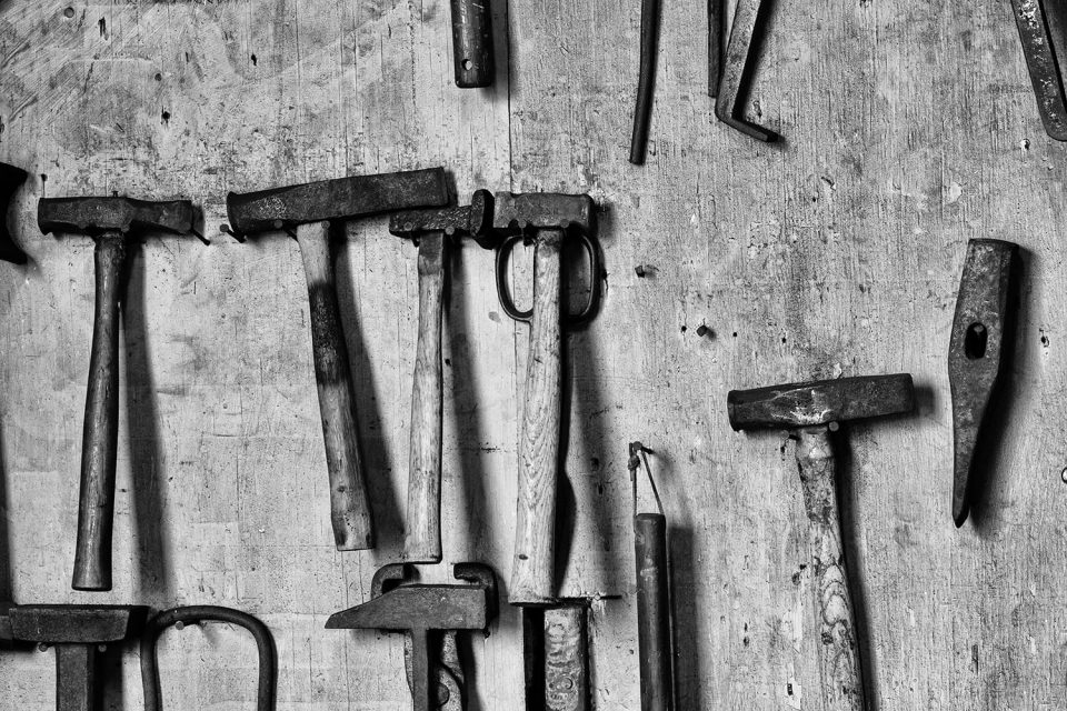 Tools in a blacksmith shop. Black and white photograph by Keith Dotson.