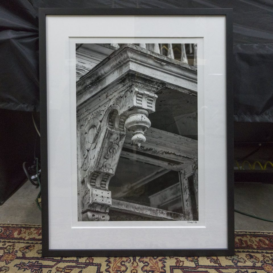Framed Keith Dotson photograph of a crusty old house in Charleston.