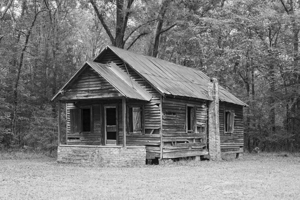 Abandoned wooden schoolhouse, black and white photograph by Keith Dotson. Click the photo to buy a fine art print here.