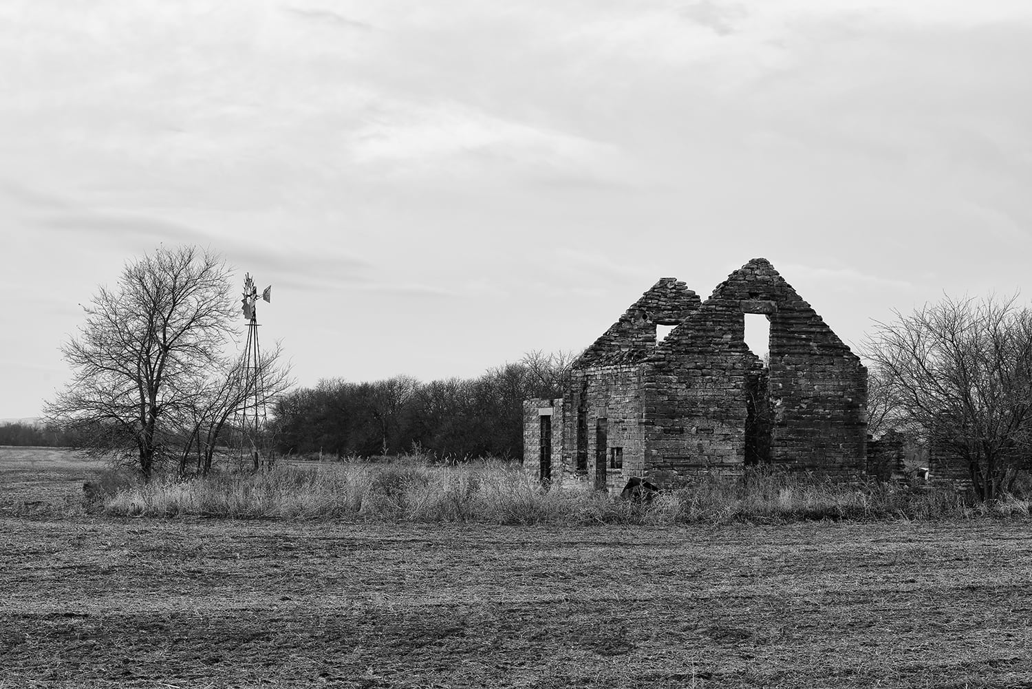 Abandoned Stone Farmhouse in Ruins: black and white photograph by Keith Dotson. Click to buy a photograph.