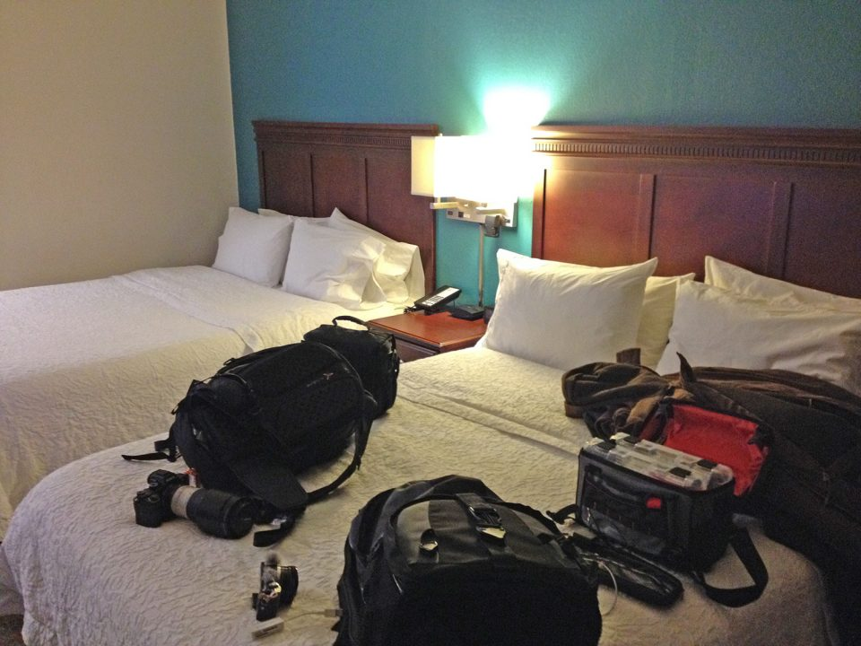 My hotel room in Madison Wisconsin, with spare bed covered in camera bags and winter gear.