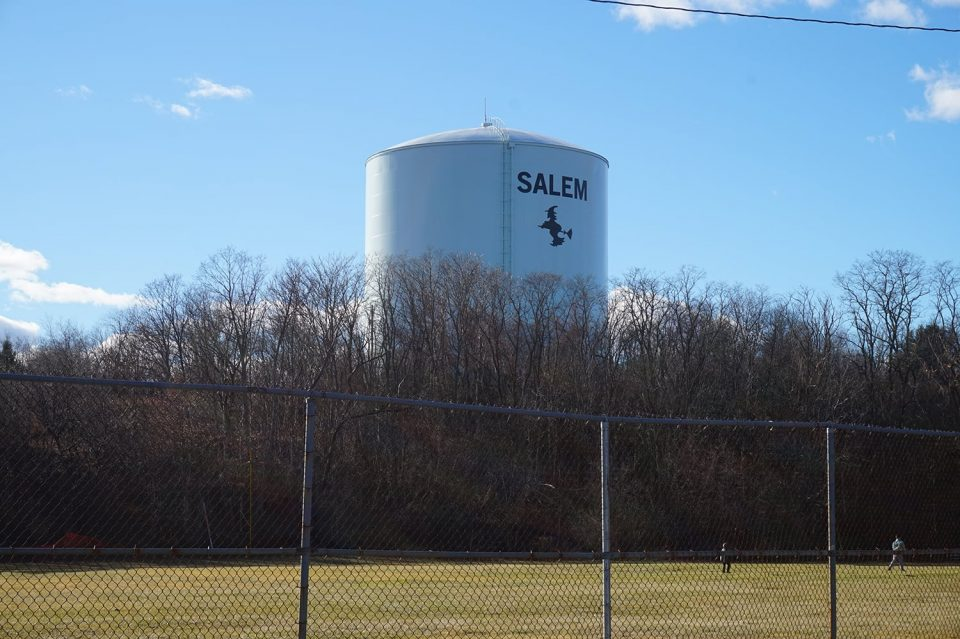 Salem has full embraced is witchy identity, as shown with this icon of a flying witch seen on a water tower just a few hundred yards from the believed location of the real gallows hill