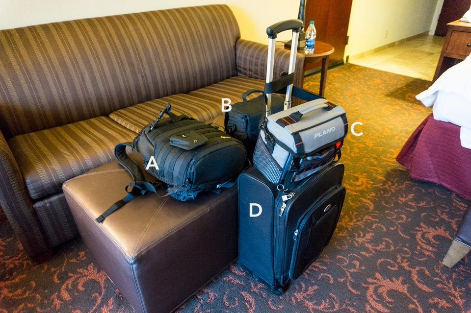 Keith Dotson's travel gear organized for travel, as seen in a hotel room in Virginia.