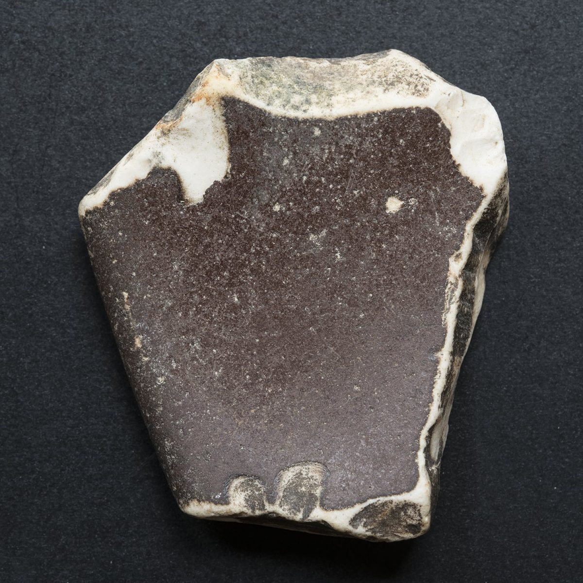 Can you help identify this object? Is it a pottery fragment or just a piece of smooth stone?