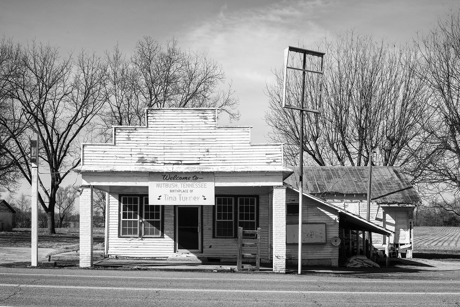 Abandoned Storefront on Highwy 19 Nutbush, Tennessee. Black and white photograph by Keith Dotson.