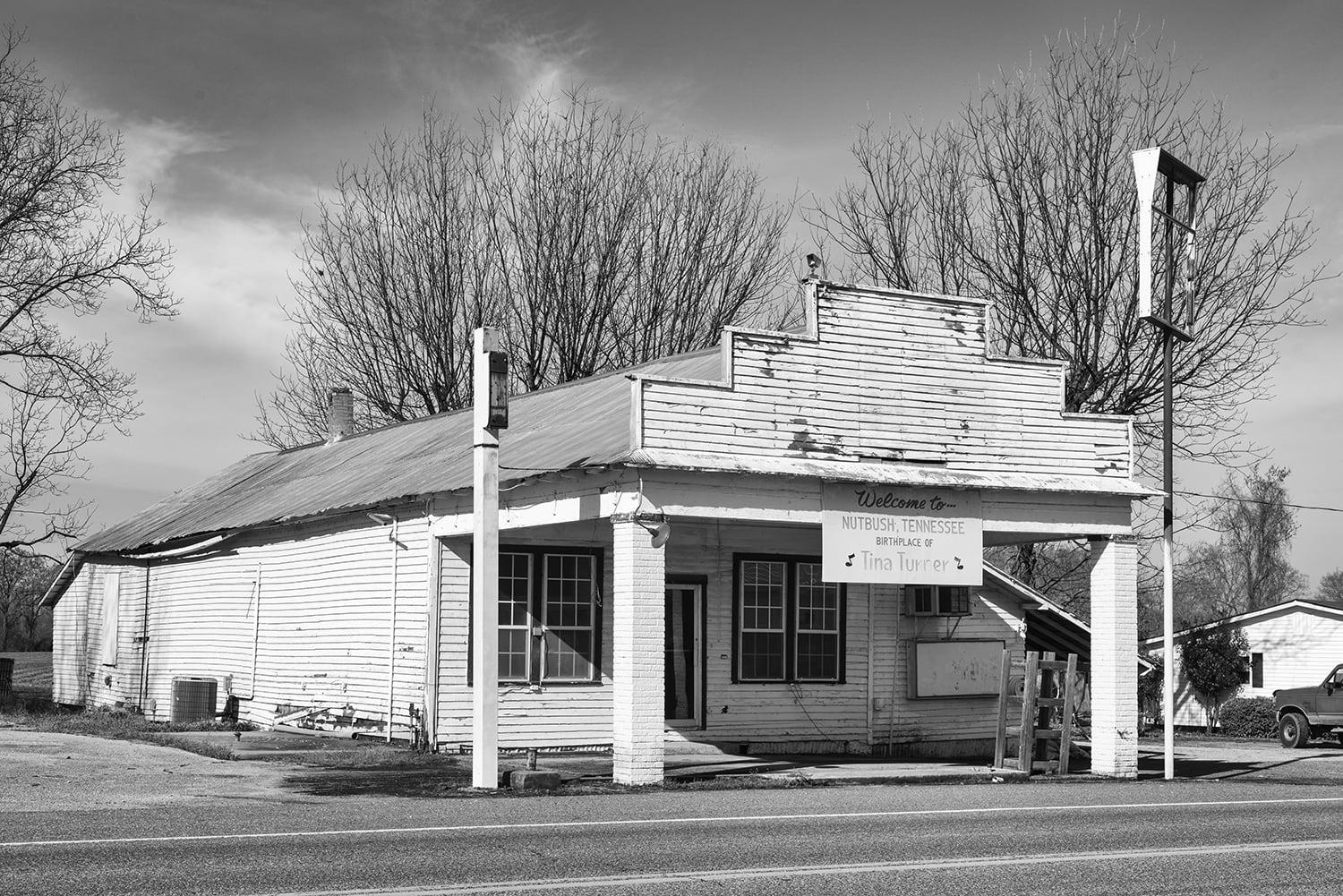 Black and white photograph of an old clapboard store building located on Highway 19 in Nutbush, Tennessee. Click to by a fine black and white print.