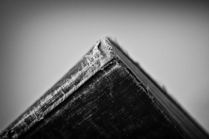 Black and white photograph of a tattered old book. Click to buy a fine art print.