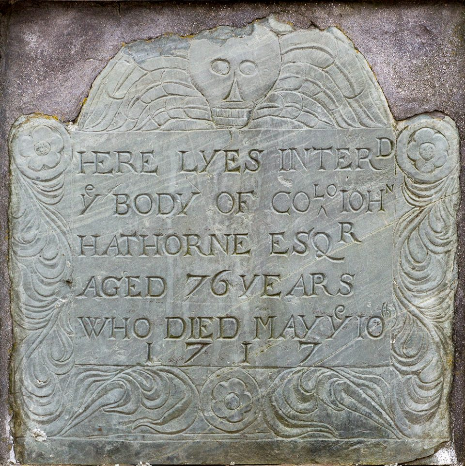 The headstone of John Hawthorne, a judge from the Salem witch trials, who dies in 1717.