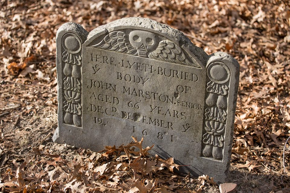 Another old headstone from the Old Burying Point, with the characteristic winged skull motif that was popular at the time. This grave holds the body of John Marston, deceased 1681.