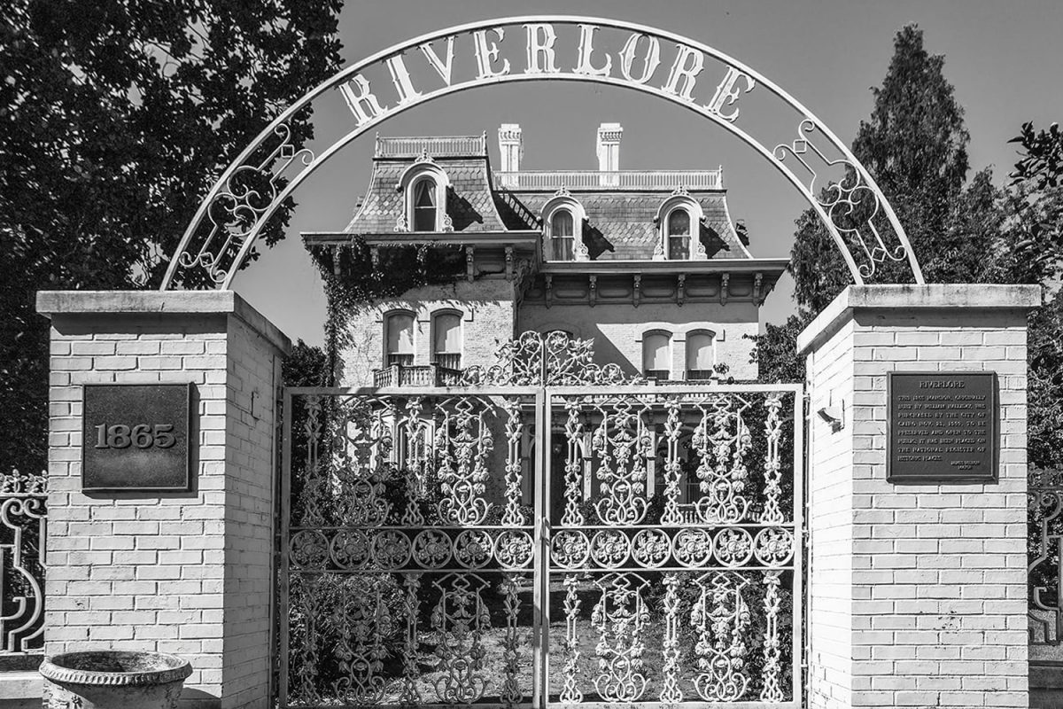 Riverlore Mansion seen through its ornate ironwork gate