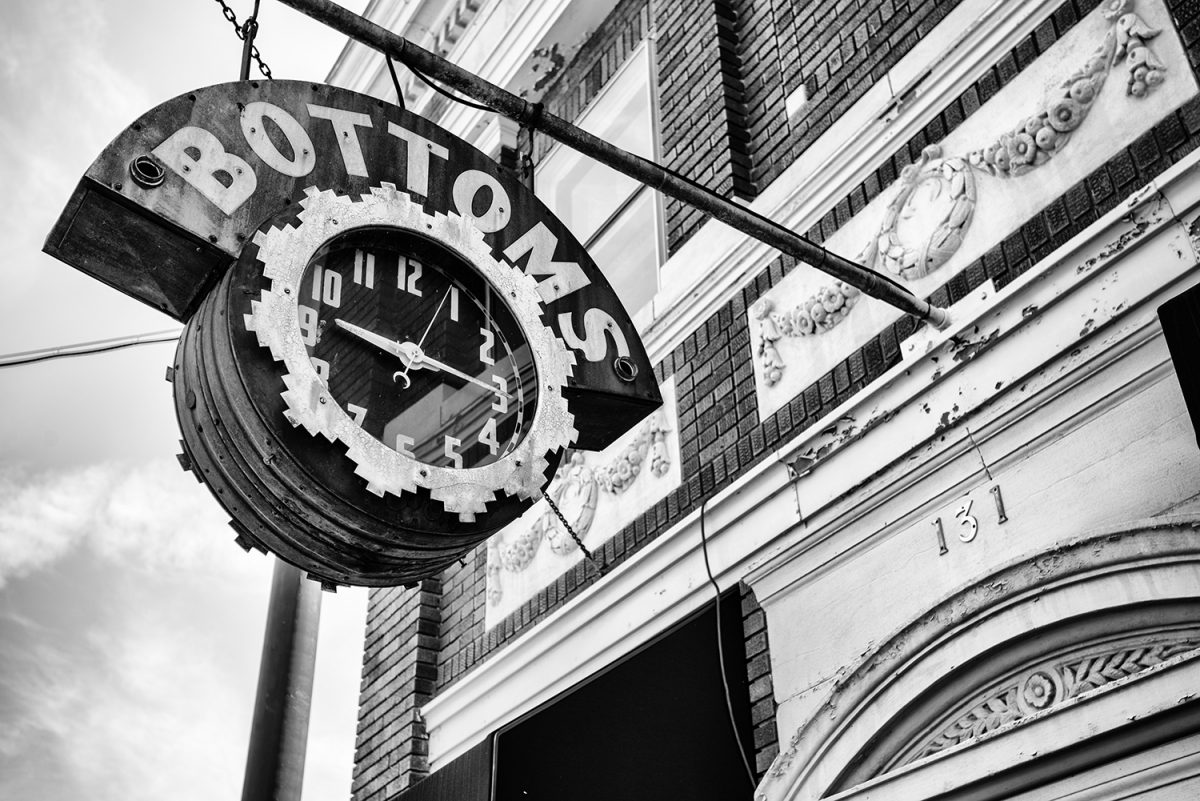 Black and white photograph of the old Bottoms Jewelers clock sign in Bardstown, Kentucky