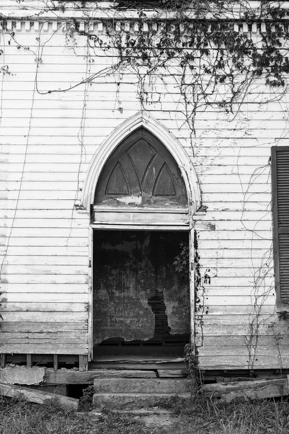 Detail of the front of the old Baptist church built 1850 in abandoned Rodney, Mississippi