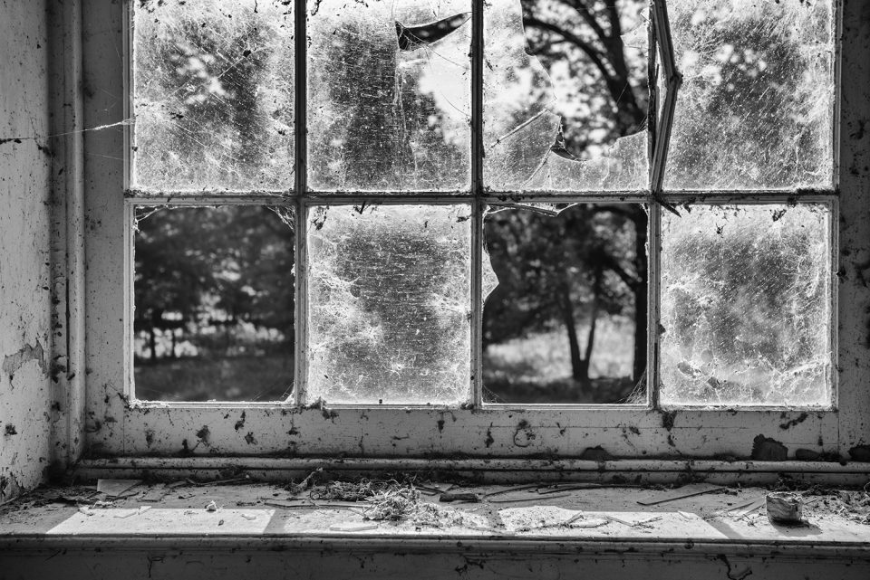 Broken windows of an abandoned building in the abandoned Rodney, Mississippi ghost town.