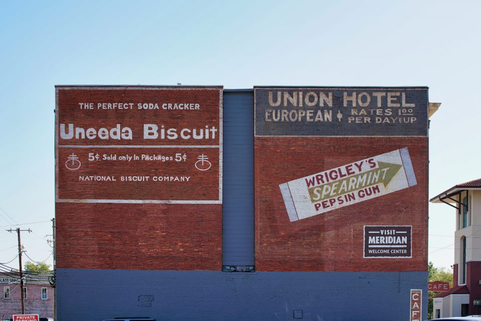 Clumsy repaints of vintage ad signs in Meridian do not reflect the authentic feel of the city's downtown