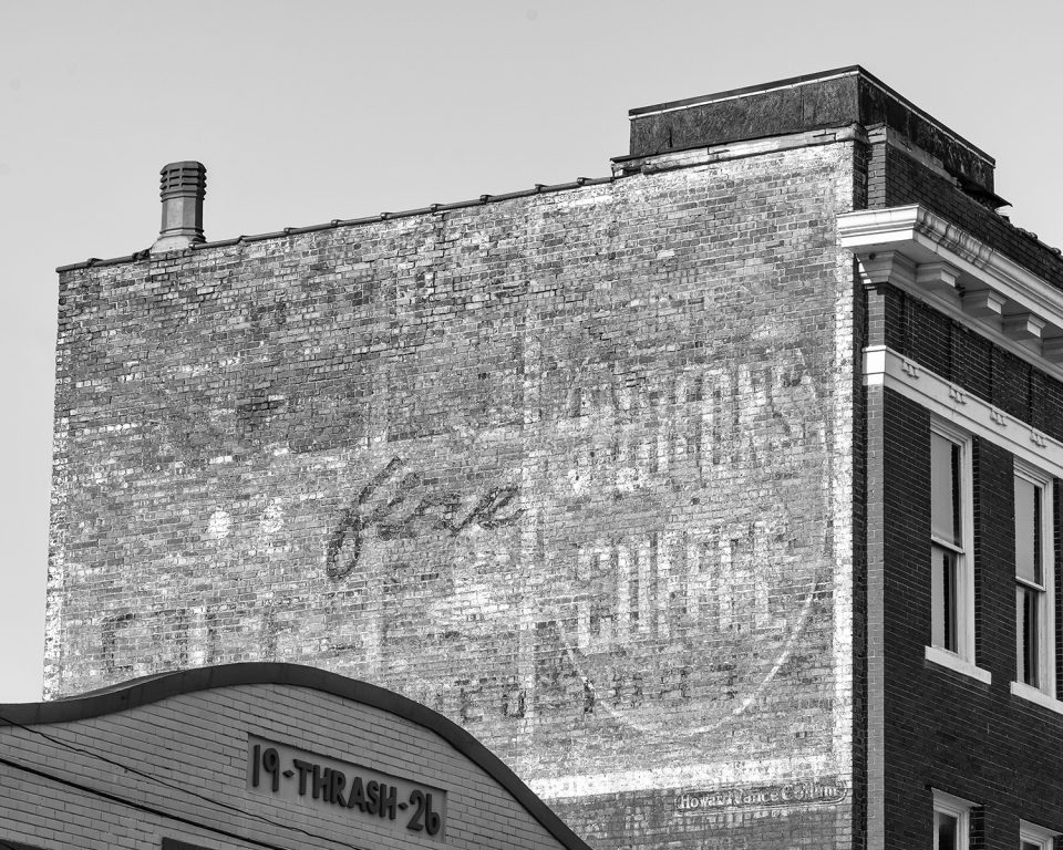 Big ghost sign for Niolon's Coffee in downtown Meridian, Mississippi. Here we can see that there are multiple layers of previous ads competing for attention.