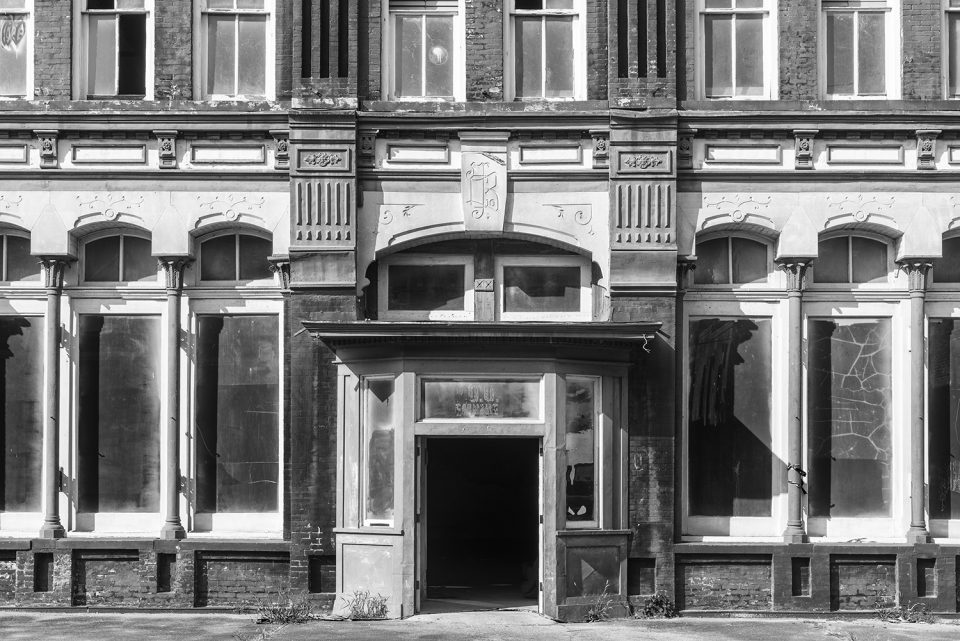 Black and white photograph of an abandoned building in Meridian, Mississippi by fine art photographer Keith Dotson.
