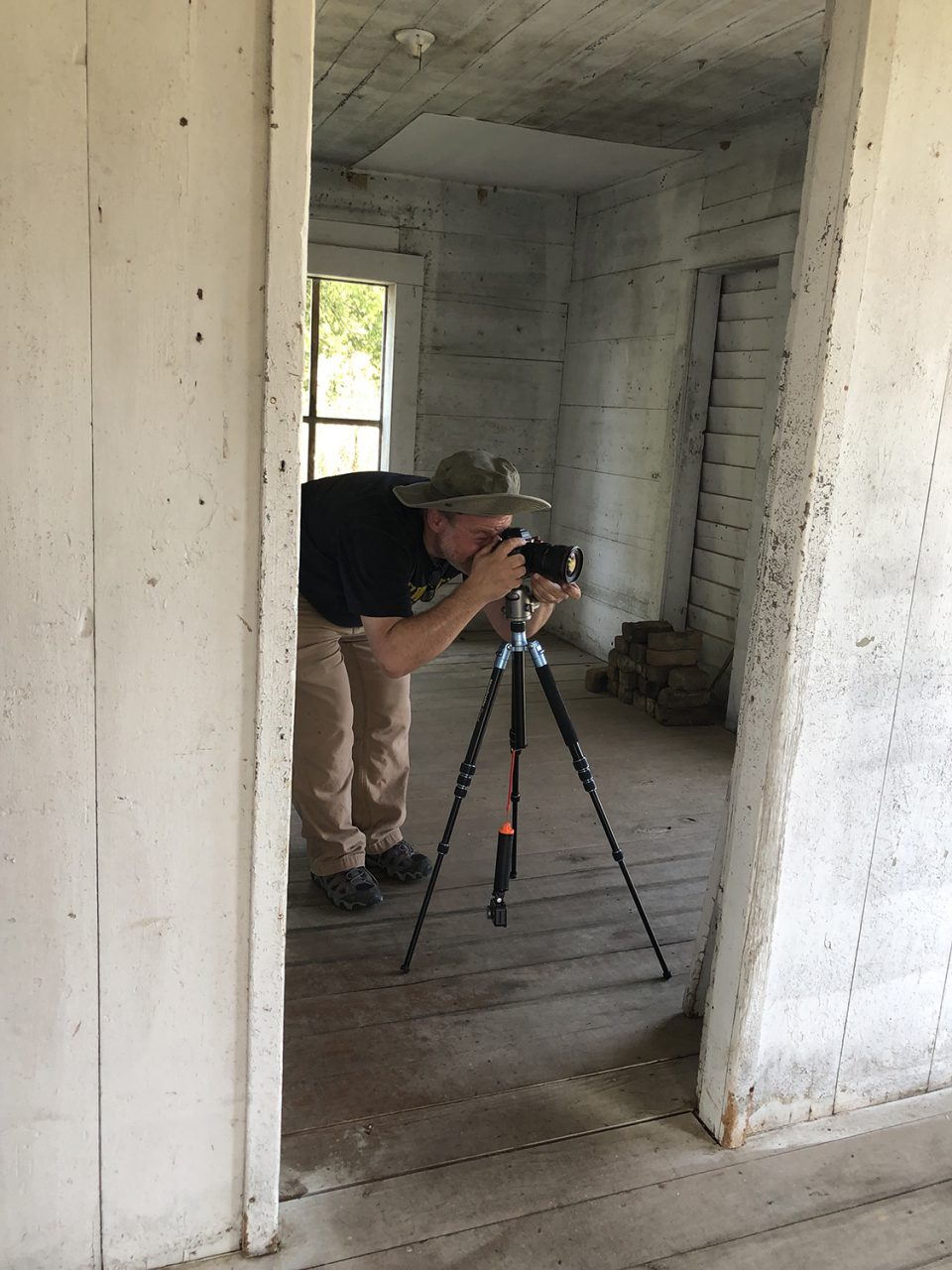 Fine art photographer Keith Dotson caught in action shooting an abandoned farmhouse.