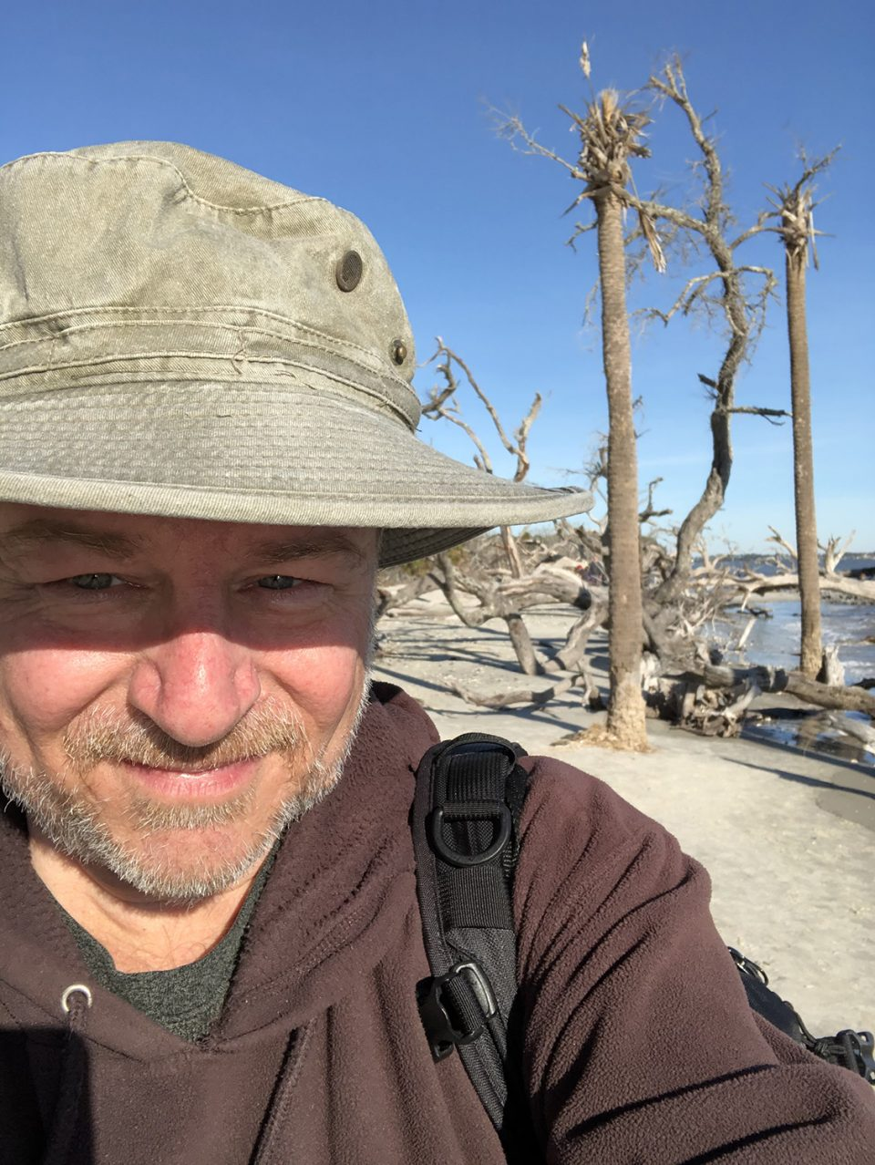 A rare selfie of fine art photographer Keith Dotson among the tree skeletons on Driftwood Beach at Jekyll Island, Georgia