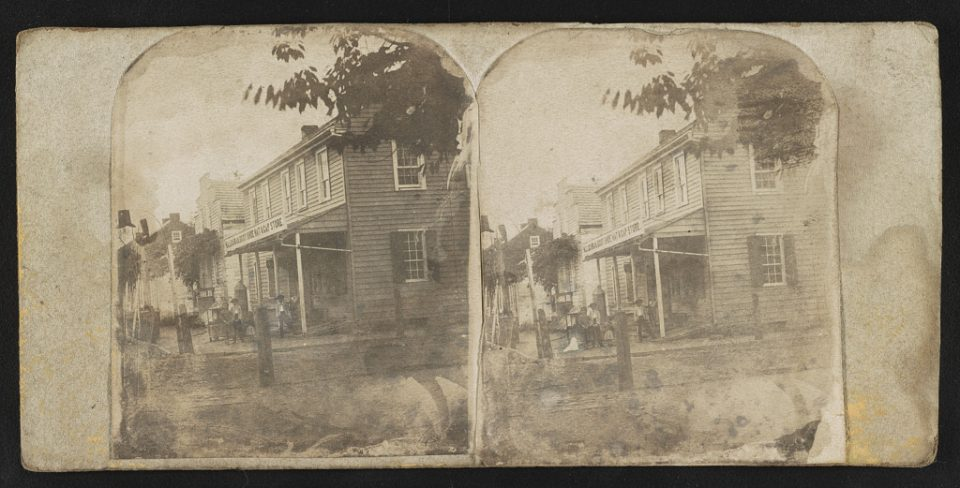 """W. Lochman Boot, Shoe, Cap, and Hat Store,"" from the Library of Congress. This is almost certainly a photograph of the shoe and boot making business owned by Charles and Benjamin, photographed by brother William."