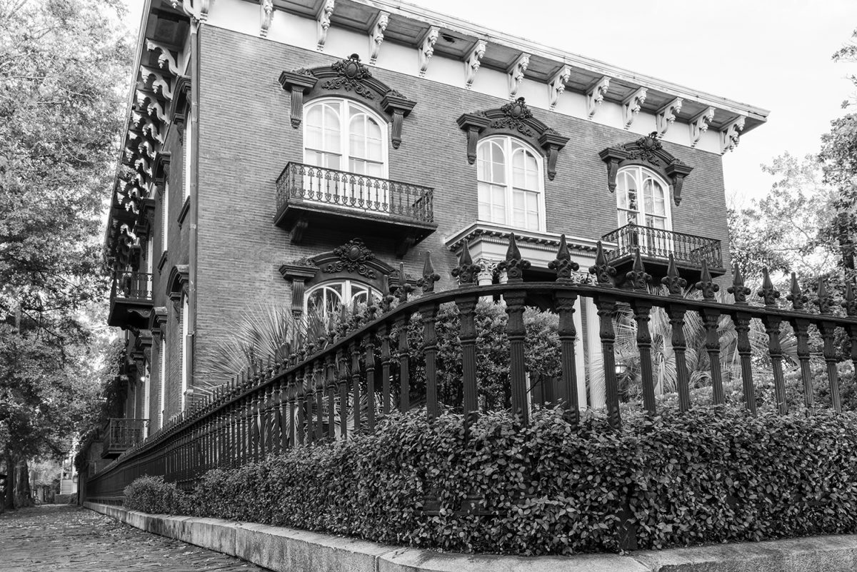 Black and white photograph of Savannah's beautiful Mercer Williams House, notorious as the location of the killing in the book Midnight in the Garden of Good and Evil