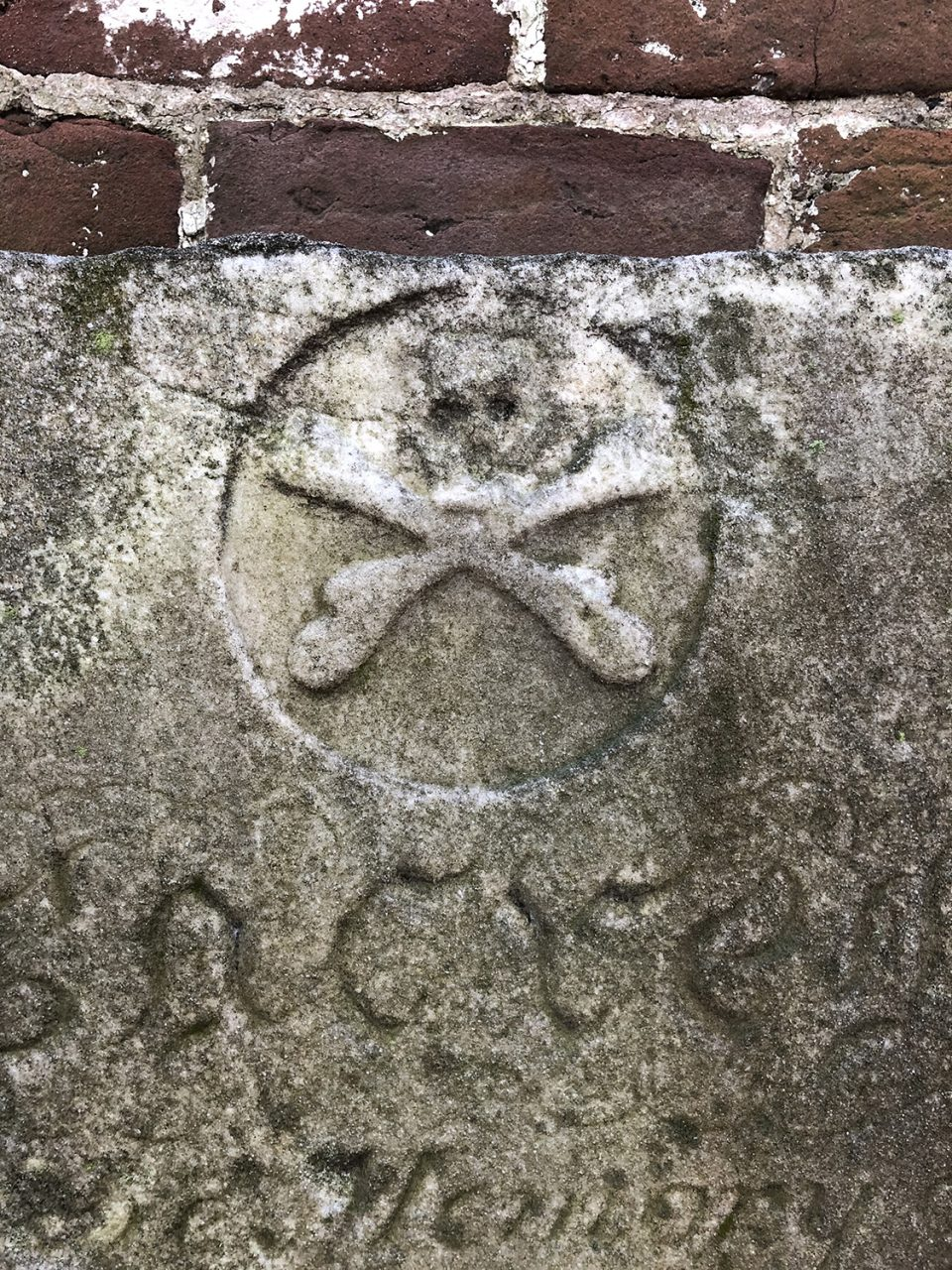 Skull and cross bones on an antique grave stone in Savannah's Colonial Cemetery.
