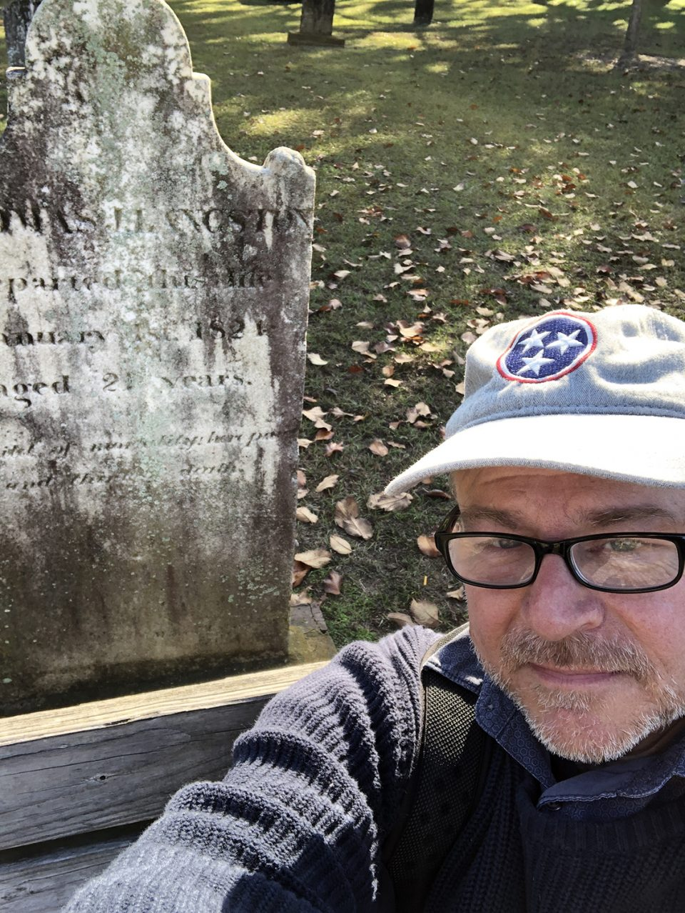 In Colonial Cemetery, park benches sit alongside very old tombstones. Here I am with the marker for Thomas J. Langston, who departed this world in 1824.