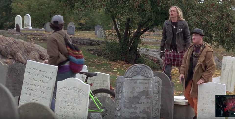 A screen shot from the movie Hocus Pocus showing the first meeting of Max and the two bullies. Did they really let that actor stand on top of an old tomb?