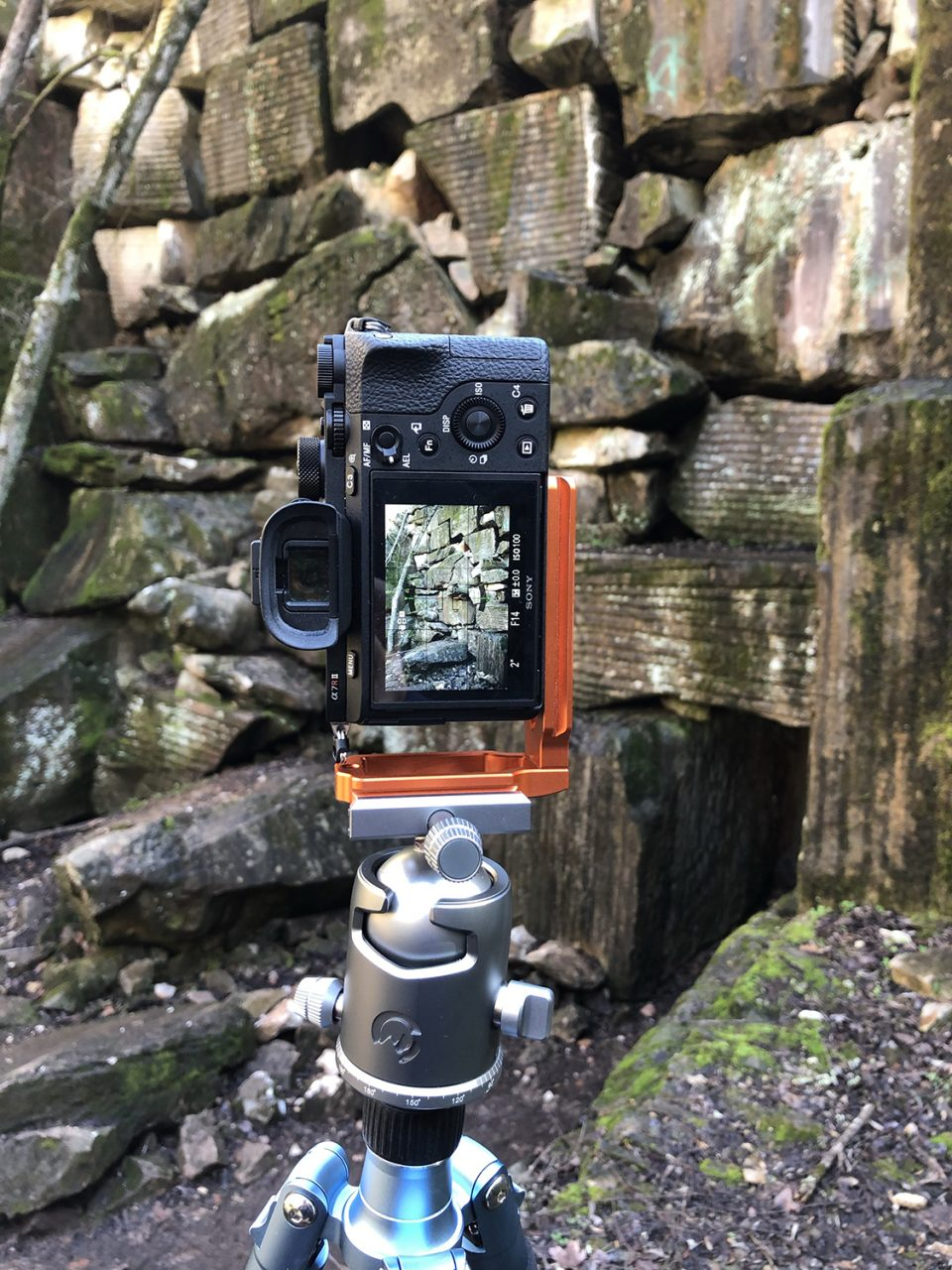 In the bottom of the quarry: camera settings visible on the LED screen.