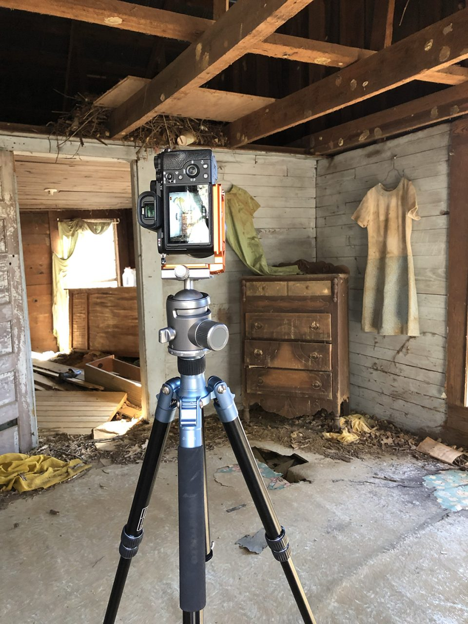 A look at my camera on a tripod inside the old house. The floor was extremely sketchy for walking but it supported the tripod with no problem.
