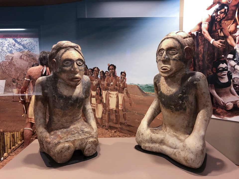 Marble effigy statues found buried at the Etowah mound site in Georgia. Photograph by Keith Dotson.