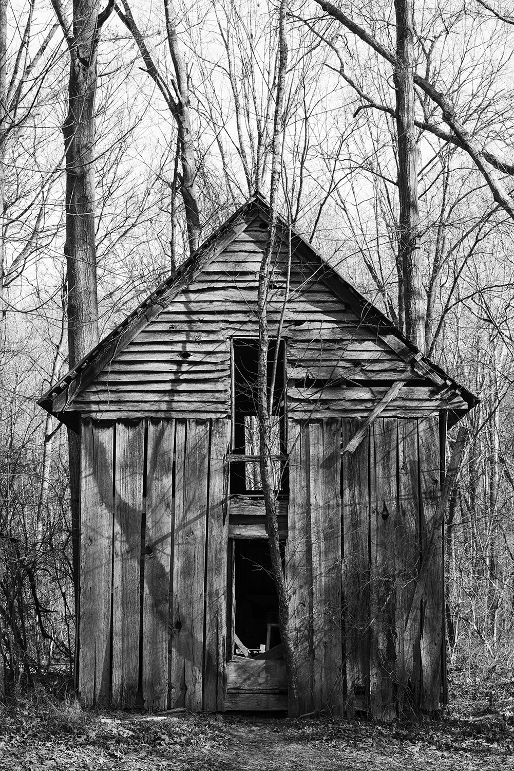 Abandoned Two-Story Farm House in the Woods - Black and White Photograph by Keith Dotson.