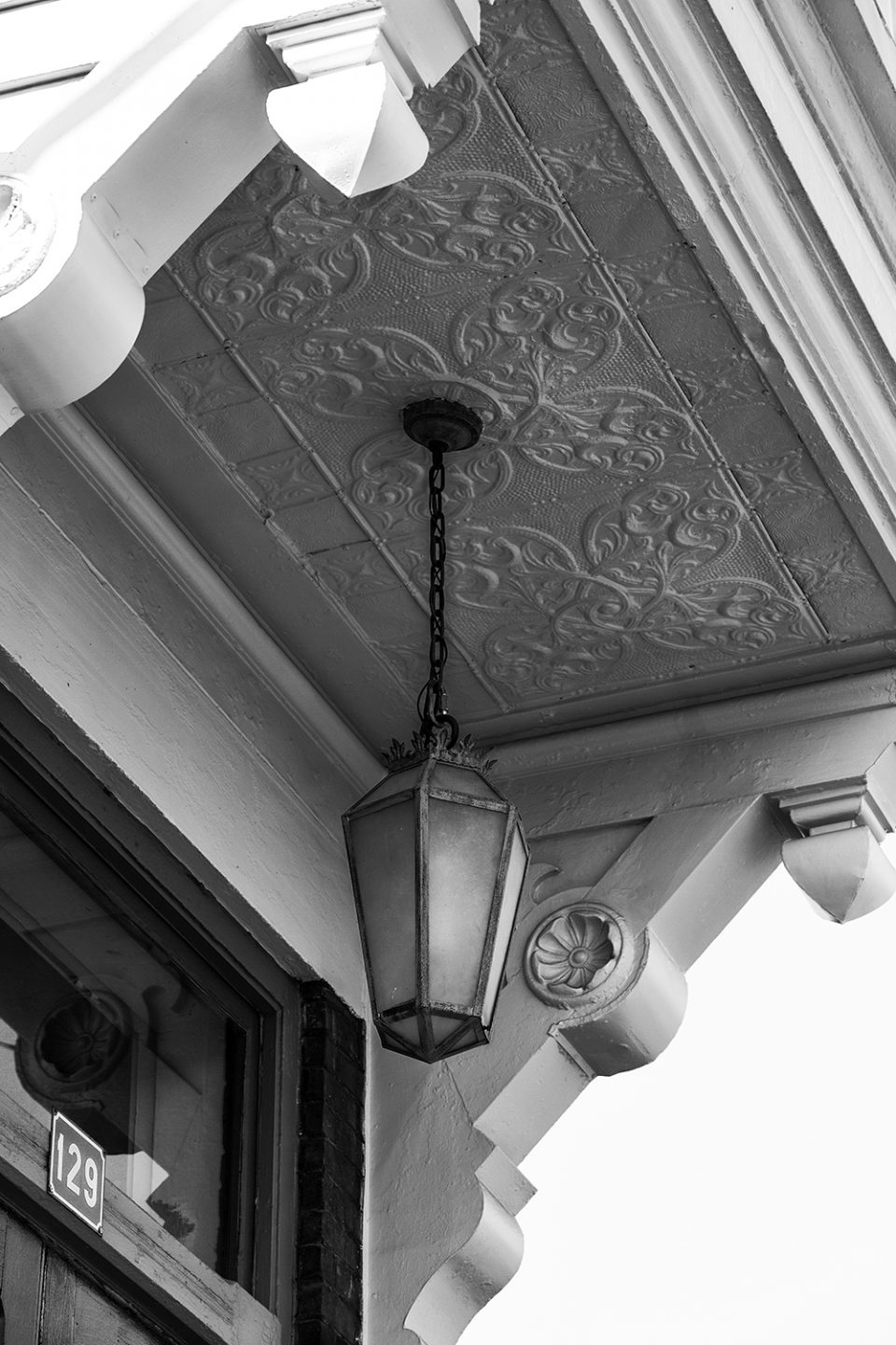 Elegant historic architectural details from a bygone era in Hopkinsville. Black and white photograph by Keith Dotson.