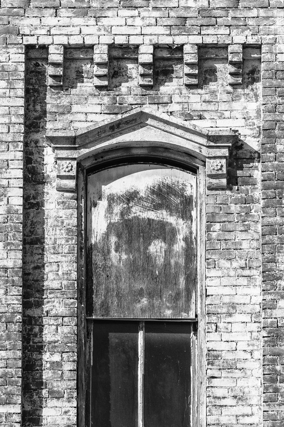 Painted bricks and a decorative hood mold on an abandoned building in Hopkinsville