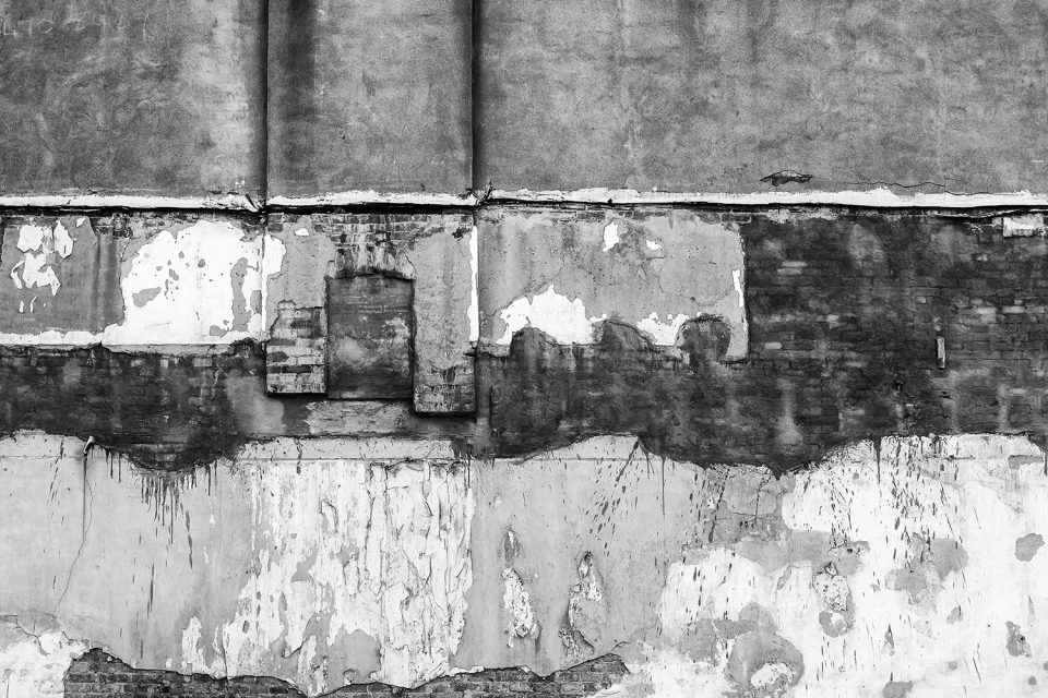 The exterior wall of this old building in Hopkinsville looks like an abstract painting. Black and white photograph by Keith Dotson.