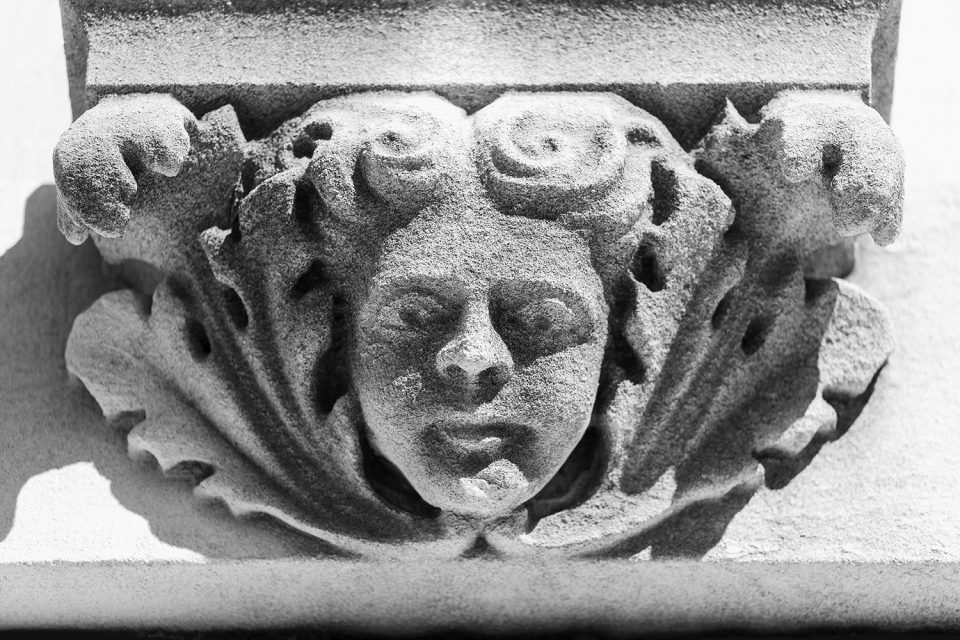 Black and white photograph of a cherub head on the exterior of the Green River Lodge - Oddfellows building in Hopkinsville