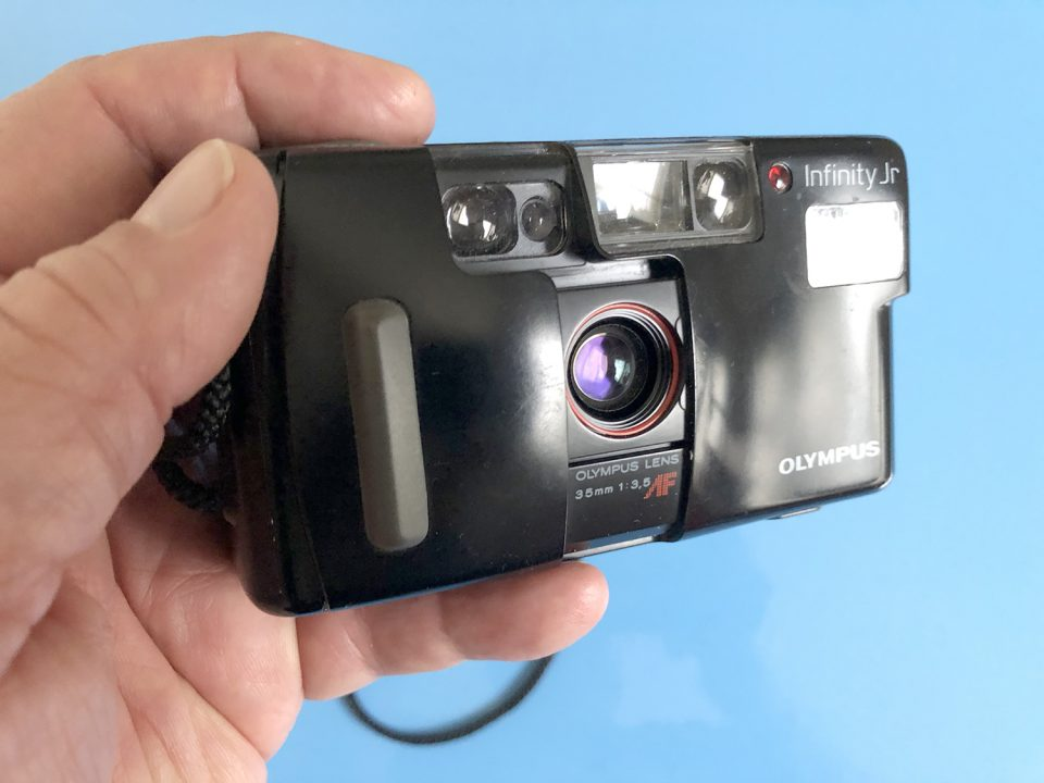 Olympus Infinity Jr 35mm film camera with auto film advance.
